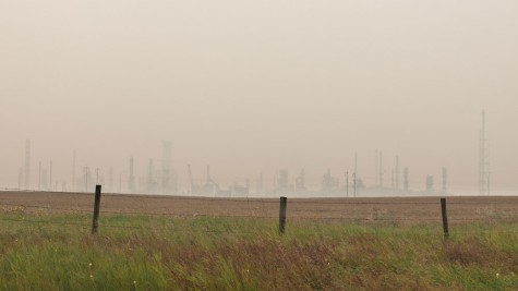 Smoke from large forest fires in BC obscures the view of the Suncor refinery complex near Edmonton, Alberta.